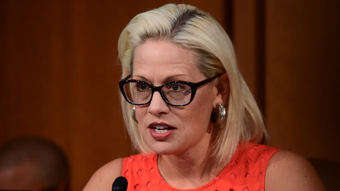 Senator Kyrsten Sinema (D-AZ) questions David Marcus, head of Facebook's Calibra (digital wallet service), during testimony before a Senate Banking, Housing and Urban Affairs Committee hearing on Examining Facebook's Proposed Digital Currency and Data Privacy Considerations on Capitol Hill in Washington, U.S., July 16, 2019. REUTERS/Erin Scott