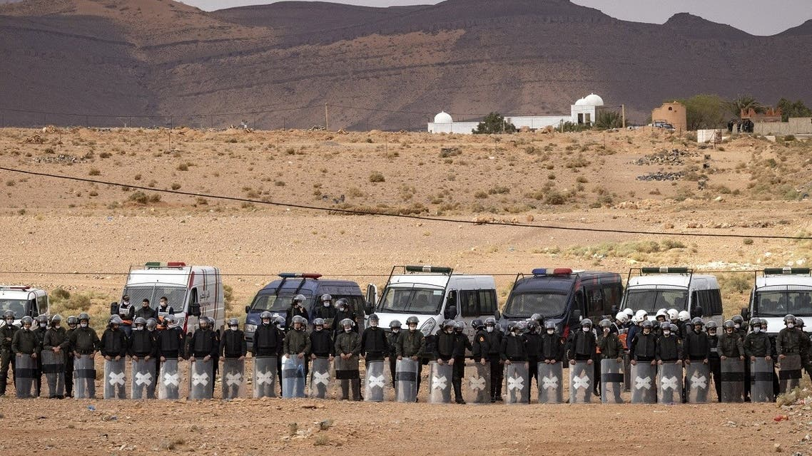 A file photo shows Moroccan security forces stand guard as Moroccan farmers protest in the city of Figuig on March 18, 2021, after Algerian authorities expelled the date growers from the Algerian territory, a border area they are traditionally authorized to farm. (Fadel Senna/AFP)