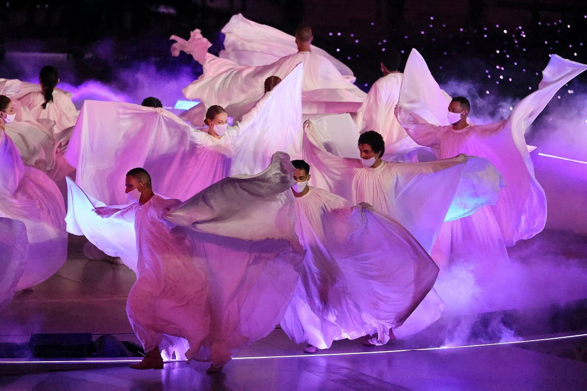 Artists perform during the opening ceremony of the Dubai Expo 2020, on September 30, 2021. (Karim Sahib/AFP)