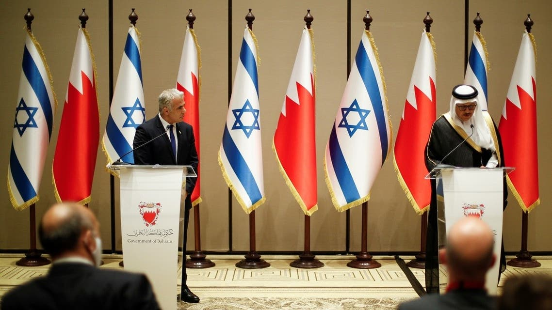 Israeli Foreign Minister Yair Lapid and Bahrain's Foreign Minister Abdullatif al-Zayani take part in a news conference, Manama, Bahrain, on September 30, 2021. (Reuters)