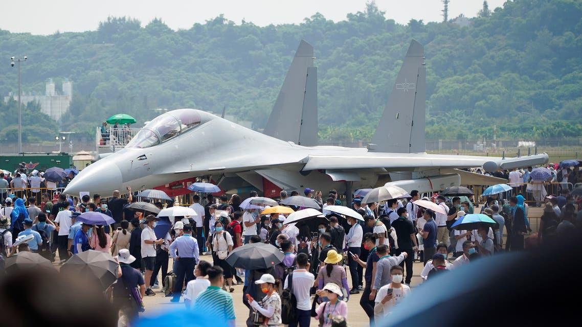Visitors look at a J-16D electronic warfare aircraft displayed at the China International Aviation and Aerospace Exhibition, or Airshow China, in Zhuhai, Guangdong province, China September 28, 2021. (Reuters)