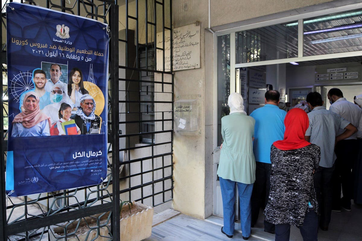 People wait to get the coronavirus disease (COVID-19) vaccine at a vaccination center in Damascus, Syria September 29, 2021. Picture taken September 29, 2021. (Reuters/Firas Makdesi)