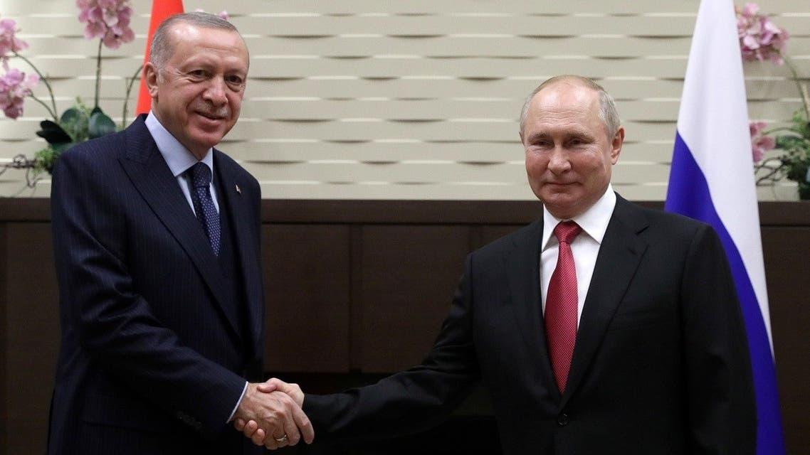 Russian President Vladimir Putin shakes hands with Turkish President Recep Tayyip Erdogan during a meeting in Sochi, Russia September 29, 2021. (Sputnik/Vladimir Smirnov/Pool via Reuters)