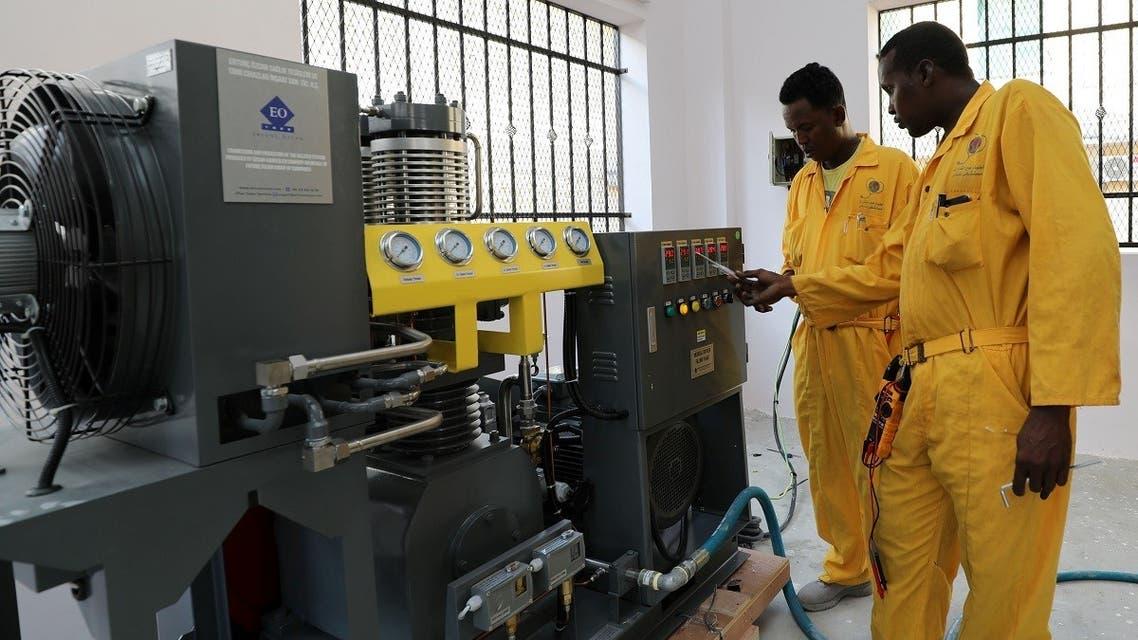 Workers install the public oxygen plant amid the coronavirus disease (COVID-19) pandemic at the Banadir Hospital in Mogadishu, Somalia September 28, 2021. (Reuters/Feisal Omar)