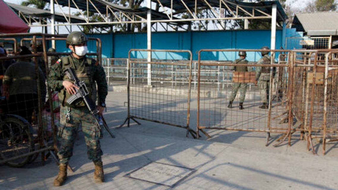 Soldiers guard the entrance to the Litoral Penitentiary a day after a deadly riot, in Guayaquil, Ecuador, Wednesday, September 29, 2021. (AP)