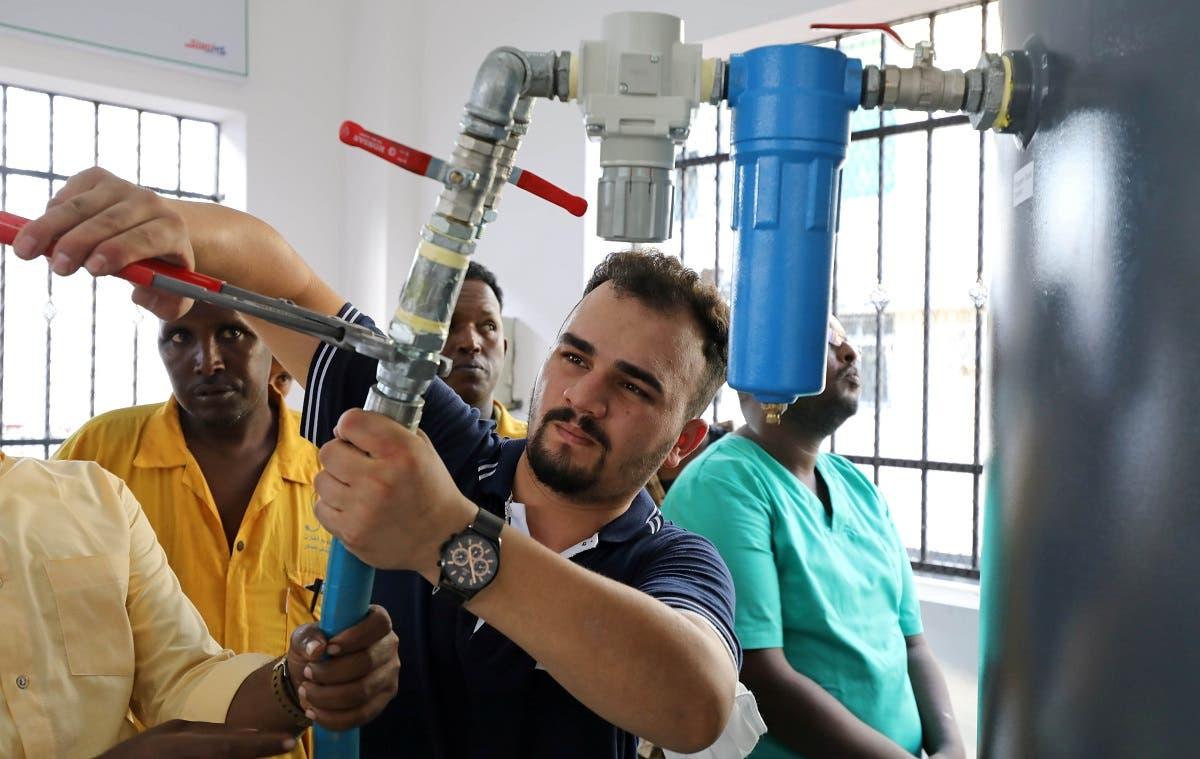 Batuhan Yucel, a Turkish technician, installs the public oxygen plant amid the coronavirus disease (COVID-19) pandemic at the Banadir Hospital in Mogadishu, Somalia September 28, 2021. (Reuters/Feisal Omar)