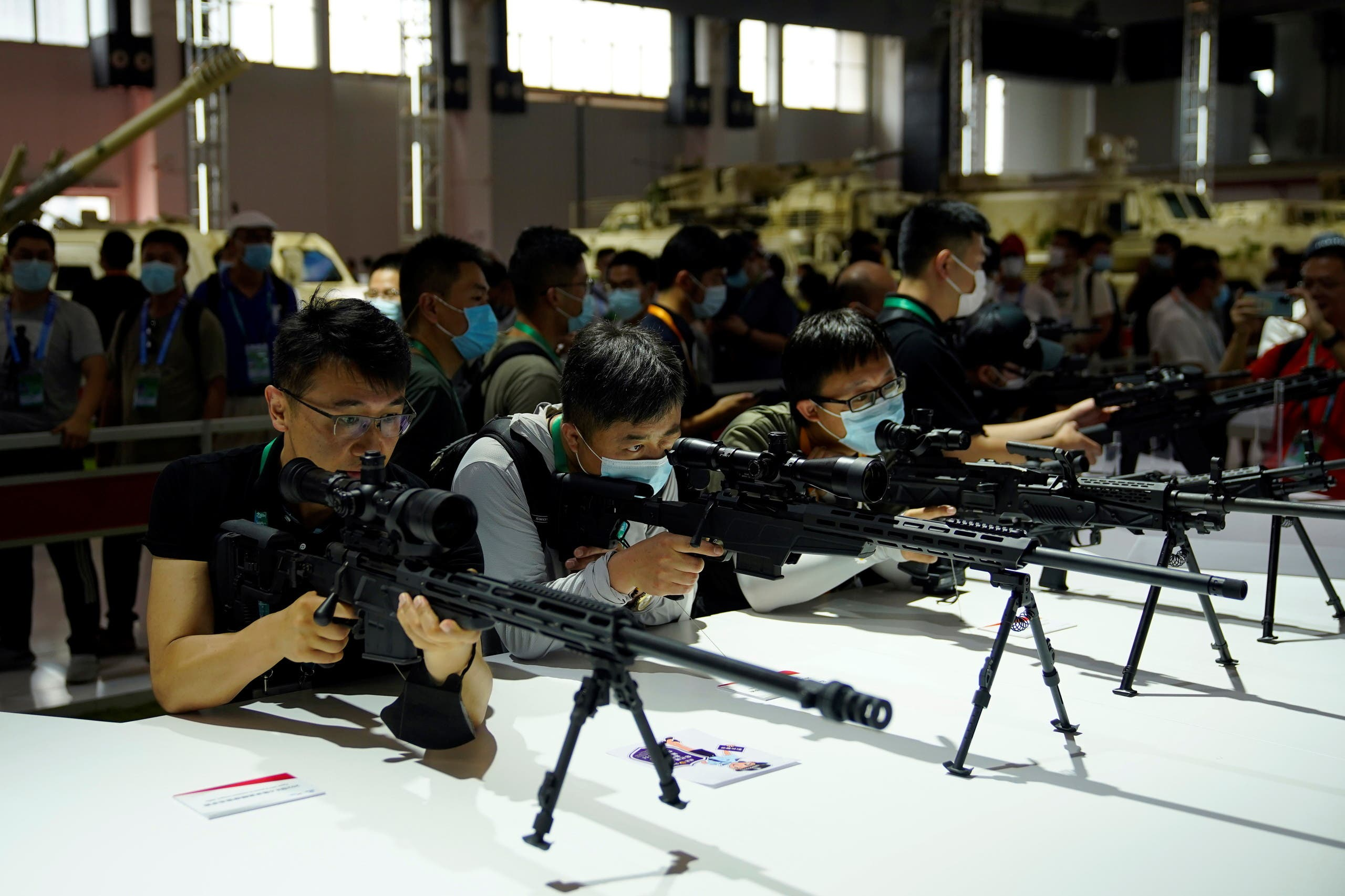 Visitors check on model rifles displayed at the China International Aviation and Aerospace Exhibition, or Airshow China, in Zhuhai, Guangdong province, China September 29, 2021. (Reuters)