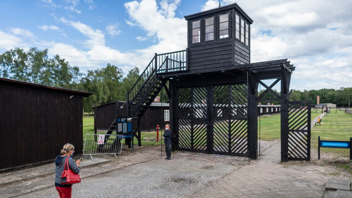 This file photo taken on July 21, 2020 shows people in front of the so called Gate of Death as they are visiting the museum in former Nazi Death Camp Stutthof, in Sztutowo, Poland. (AFP)
