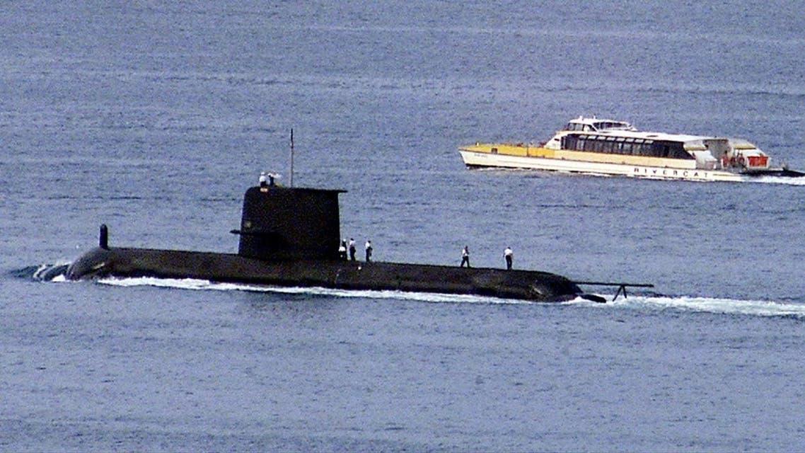 A Rivercat ferry passes by the Royal Australian Navy's Collins-class submarine HMAS Waller as it leaves Sydney Harbour. (Reuters)