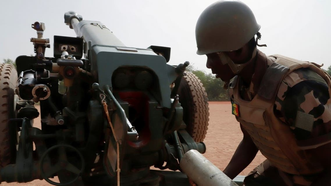 A Malian soldier of the 614th Artillery Battery is pictured during a training session on a D-30 howitzer with the European Union Training Mission (EUTM), to fight extremists, in the camp of Sevare, Mopti region, in Mali on March 23, 2021. (Reuters)