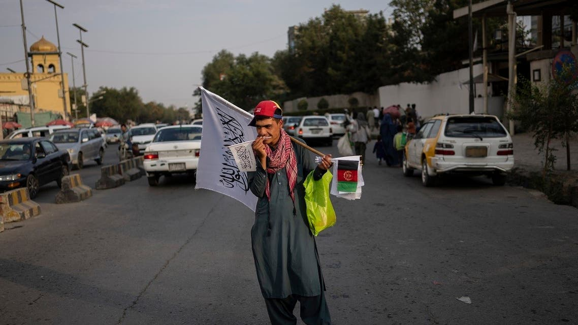 A street vendor sells Taliban and Afghan flags on a street in Kabul, Afghanistan, on Sept. 30, 2021. (AP)