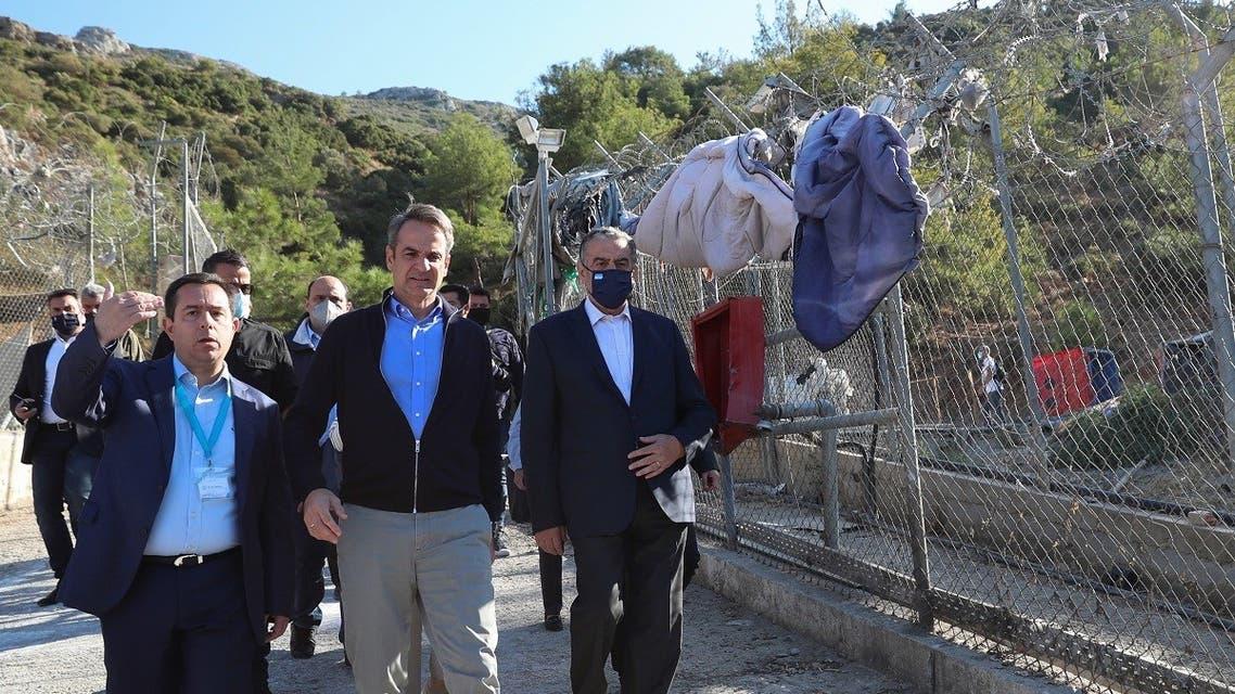 Greek Prime Minister Kyriakos Mitsotakis and Migration Minister Notis Mitarachi visit a disused migrant camp on the island of Samos, Greece, October 1, 2021. (Reuters/Costas Baltas)