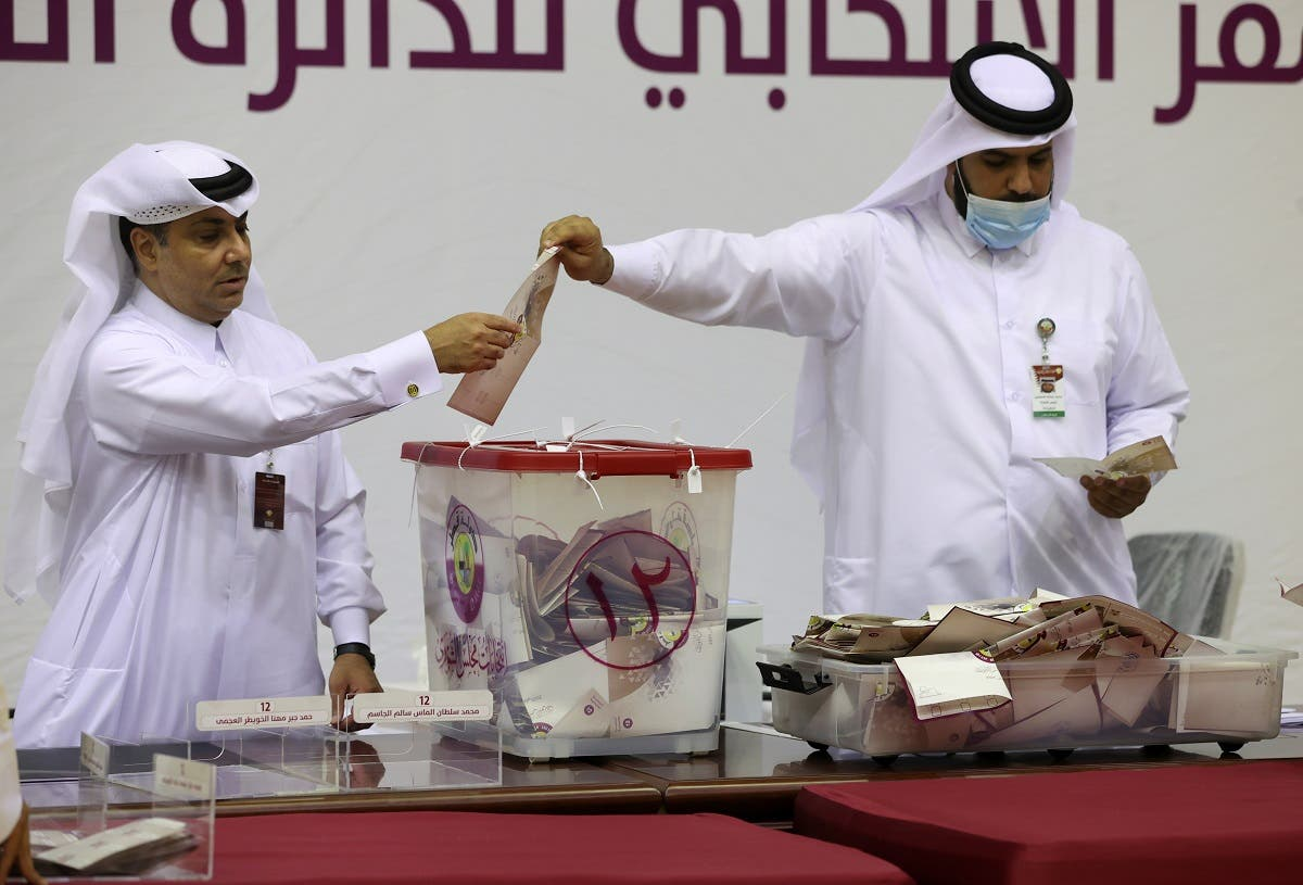 Qatari members of staff close the polling station and start counting votes during the Gulf Arab state's first legislative elections for two-thirds of the advisory Shura Council, in Doha, Qatar, October 2, 2021. (Reuters)