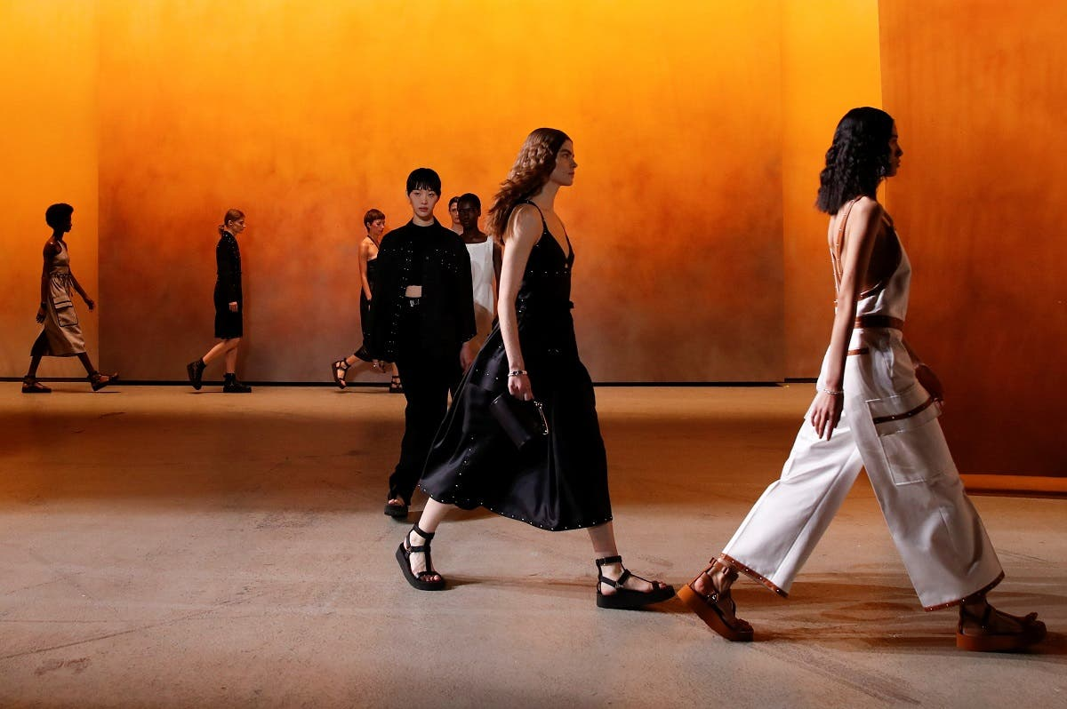Models present creations by designer Nadege Vanhee-Cybulski as part of a Spring/Summer 2022 women's ready-to-wear collection show for fashion house Hermes during Paris Fashion Week in Paris, France. (Reuters)