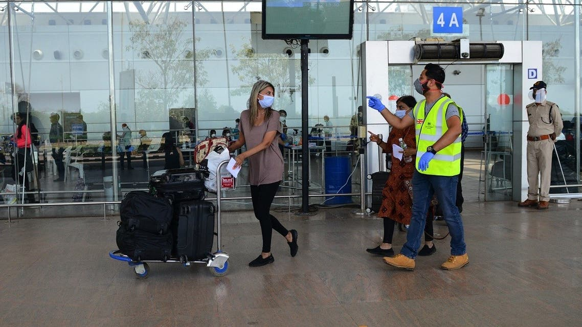 A British national arrives at the departure terminal before boarding a special British Airways flight bound to London during a government-imposed nationwide coronavirus lockdown at the Sardar Vallabhbhai Patel International (SVPI) airport in Ahmedabad on April 15, 2020. (Sam Panthaky/AFP)