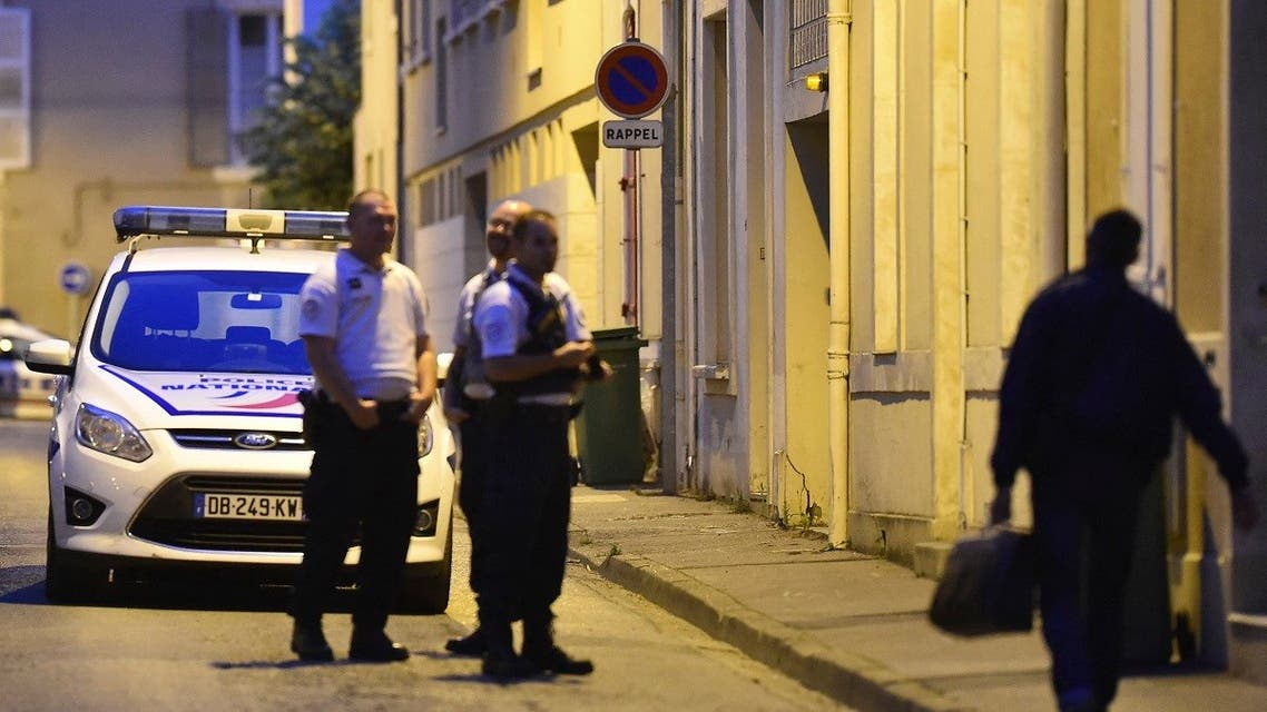 Police officers cordon off the area next to the house of late French magistrate Jean-Michel Lambert who was found dead at his home, on July 11, 2017, in Le Mans. (AFP)