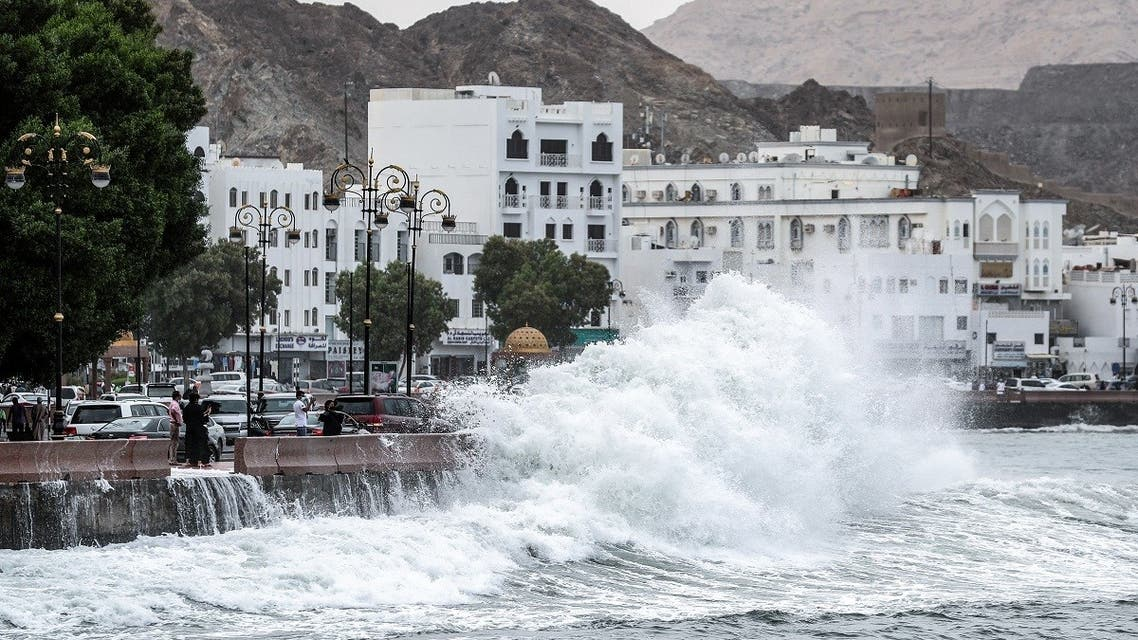 High waves break on the Mutrah sea side promenade in the Omani capital Muscat on October 2, 2021, as the Shaheen tropical storm hits the country. (AFP)