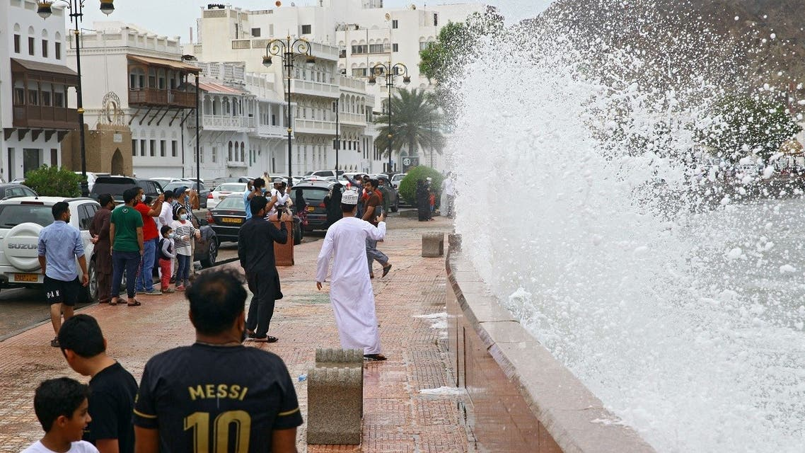 High waves break on the sea side promenade in the Omani capital Muscat on October 2, 2021, as the Shaheen tropical storm hits the country. (AFP)