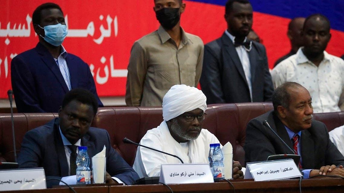 Head of the Sudan Liberation Movement and governor of Darfur Mini Minawi (L) and head of the Justice and Equality Movement and Finance Minister Gibril Ibrahim (C), as well as other political leaders, hold a conference entitled the National Consensus Charter of the Forces of Freedom and Change in Sudan's capital Khartoum, announcing the formation of an alliance separate from the country's main civilian bloc, on October 2, 2021. (AFP)
