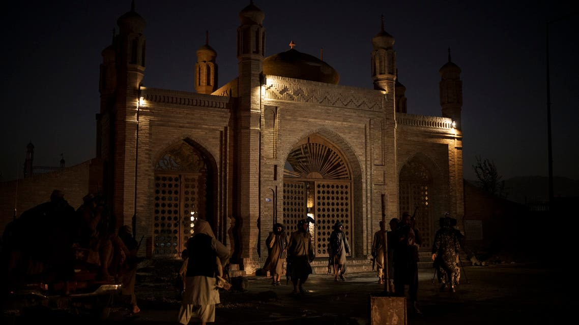 Taliban fighters walk at the entrance of the Eidgah Mosque after an explosion in Kabul, Afghanistan, Sunday, Oct. 3, 2021. (AP)
