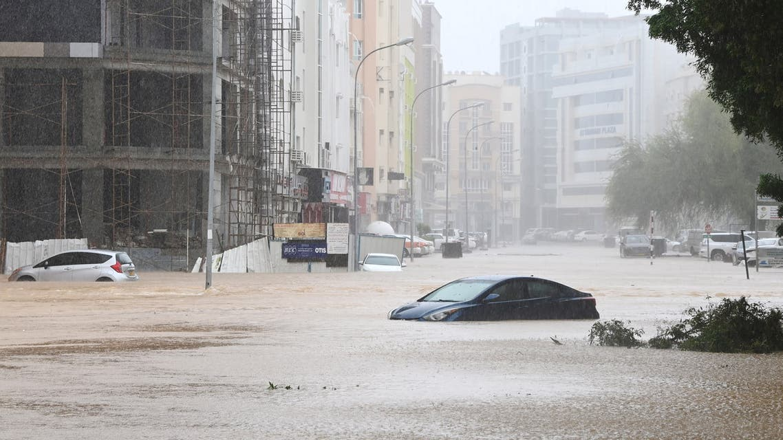 Cars are seen abandoned on a flooded street as Cyclone Shaheen makes landfall in Muscat Oman, October 3, 2021. REUTERS/Sultan Al Hassani NO RESALES. NO ARCHIVES
