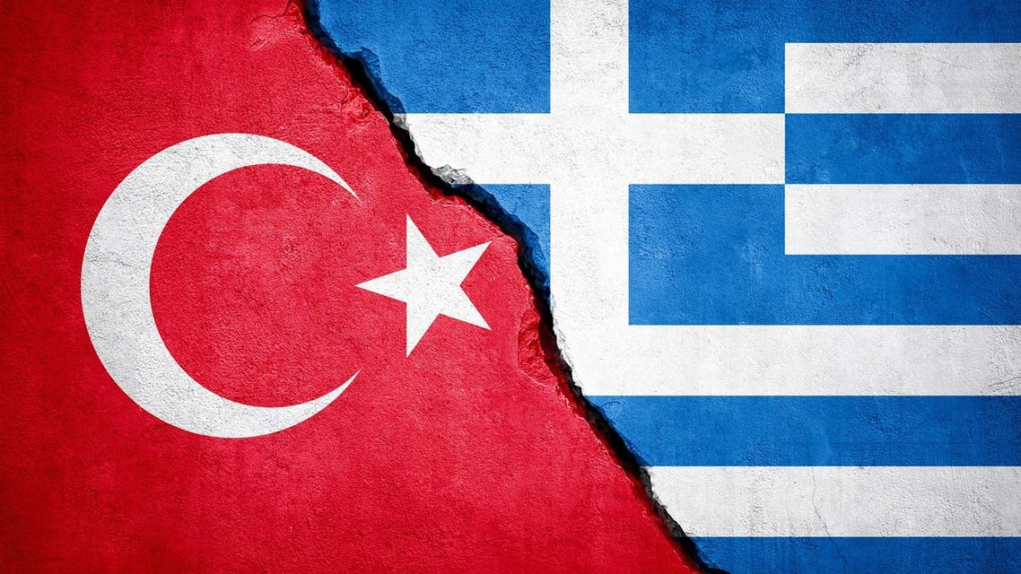 Greece and Turkey two flags together textile cloth fabric texture stock photo