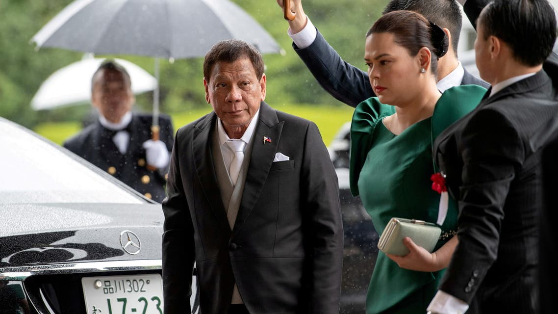 FILE PHOTO: Philippines President Rodrigo Duterte arrives with daughter and first lady Sara Duterte-Carpio to attend the enthronement ceremony of Japan's Emperor Naruhito in Tokyo, Japan October 22, 2019. Carl Court/Pool via REUTERS/File Photo