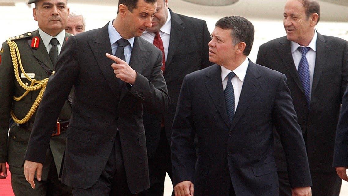Syria's President Bashar al-Assad speaks to Jordan's King Abdullah (front R) at Amman airport March 20, 2009. (Reuters)