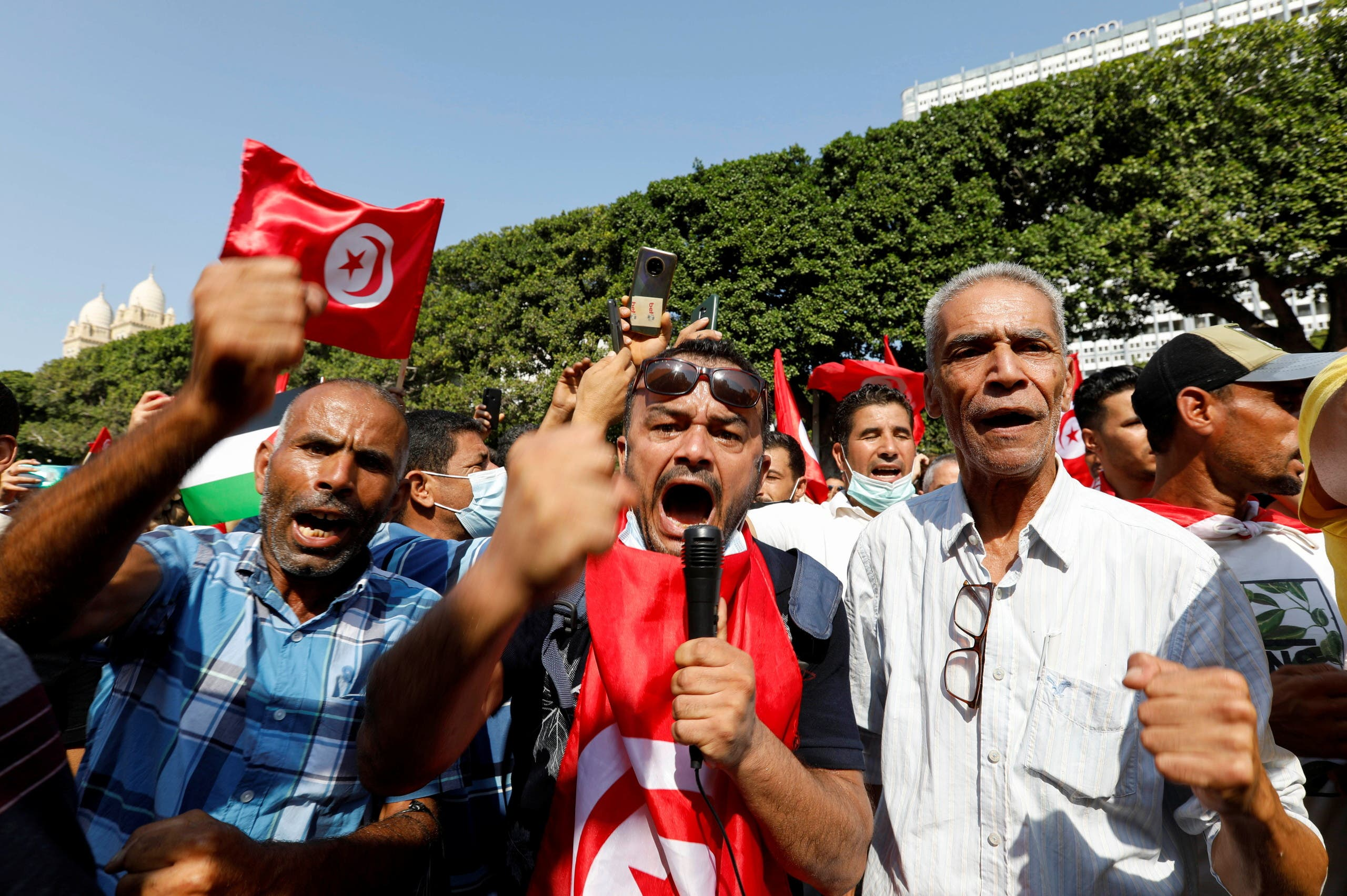 Supporters of Tunisian President Kais Saied rally in support of his seizure of power and suspension of parliament, in Tunis, Tunisia, October 3, 2021. REUTERS/Zoubeir Souissi