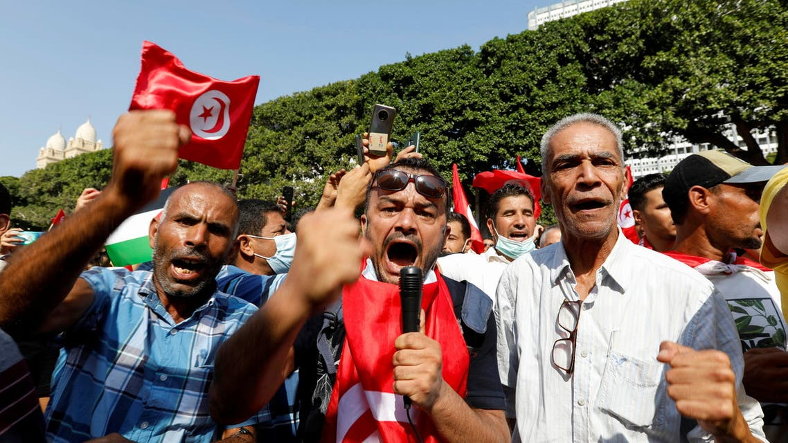 Supporters of Tunisian President Kais Saied rally in support of his seizure of power and suspension of parliament, in Tunis, Tunisia, Oct. 3, 2021. (Reuters)