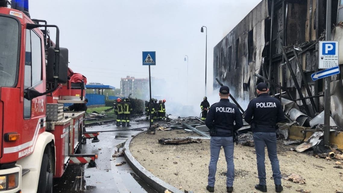 This handout picture made available by the Italy's Polizia di Stato shows the site of a plane crash in the Milan suburb of San Donato on October 3, 2021. (AFP)