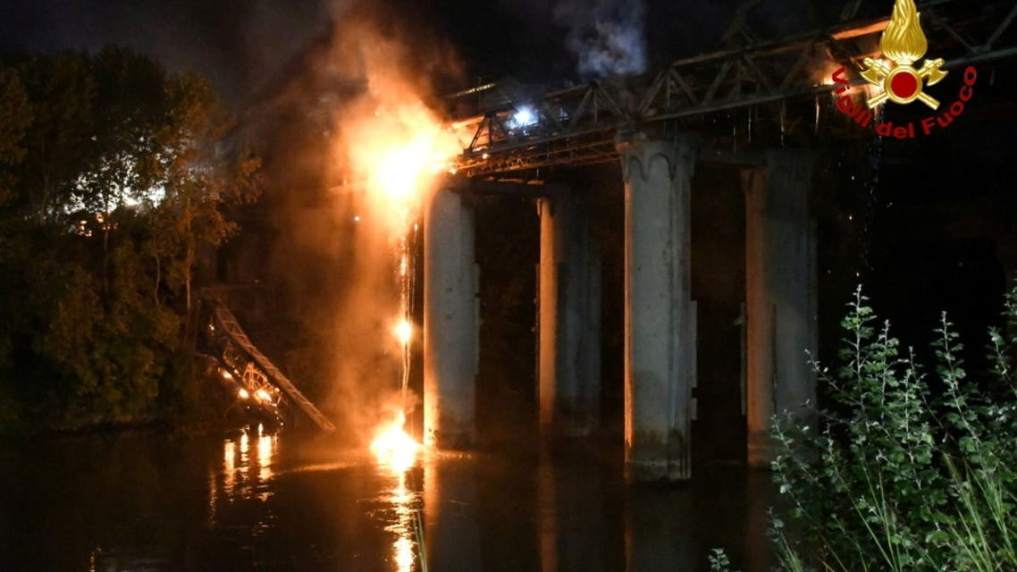 A fire engulfs iconic 'Iron Bridge' in Rome, Italy, October 3, 2021. (Reuters)