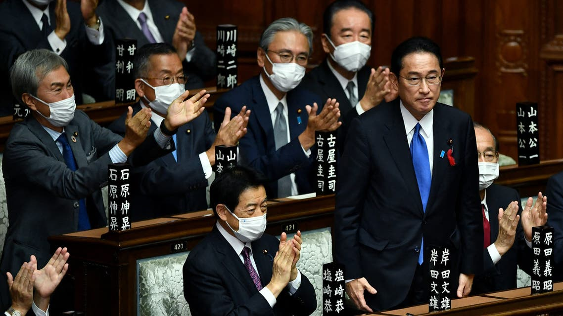 Leader of Japan's rulimg Liberal Democratic Party (LDP) Fumio Kishida (C) is applauded after being elected as new prime minister at the lower house of parliament in Tokyo on October 4, 2021