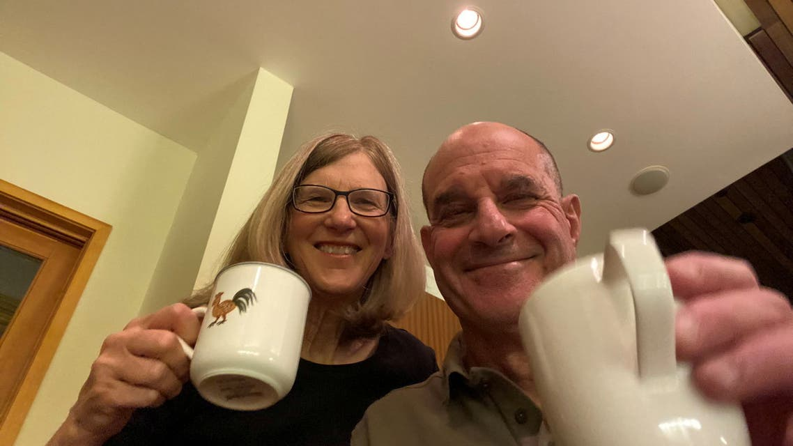 David Julius, PhD, professor and chair of University of California, San Francisco's Department of Physiology, poses with Professor Holly Ingraham after hearing the news that he'd won the 2021 Nobel Prize for Physiology or Medicine, in San Francisco, California, U.S. October 4, 2021, in this image obtained from social media.  (Reuters)