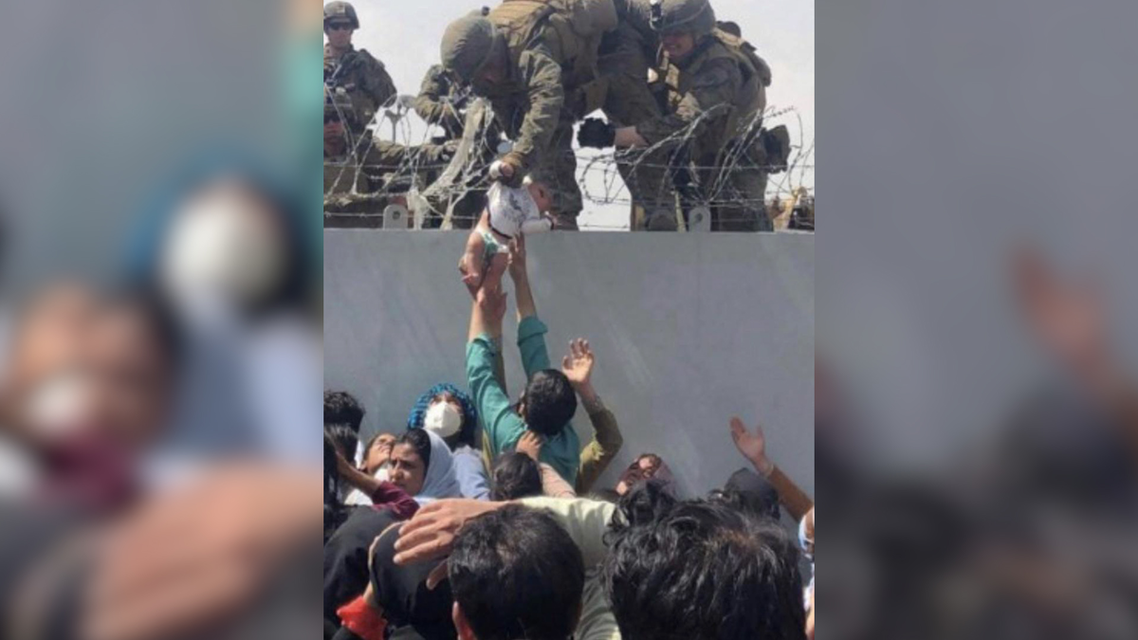 Afghan baby 'Liya' being rescued with the help of a US soldier during the Taliban takeover in Kabul in August 2021. (Twitter)