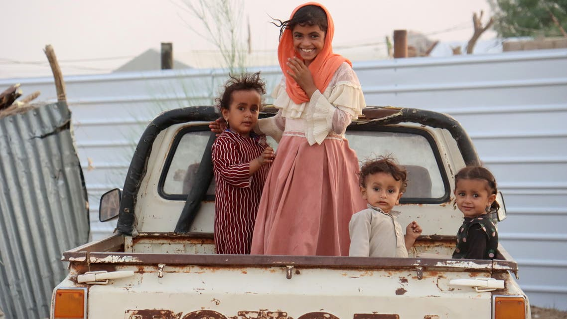Children ride on the back of a truck at a camp for internally displaced people (IDPs) in Marib, Yemen September 9, 2021. Picture taken September 9, 2021. REUTERS/Ali Owidha TPX IMAGES OF THE DAY