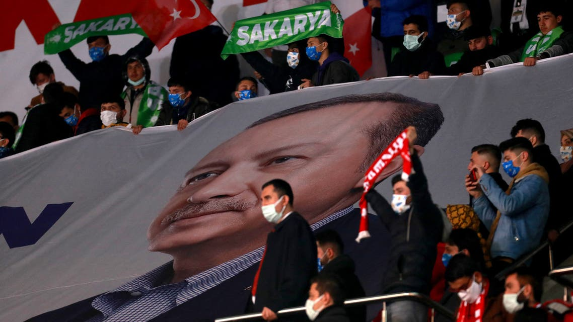 Turkish President and leader of Justice and Development (AK) Party, Recep Tayyip Erdogan addresses his supporters during a political meeting of his ruling party AKP, in Ankara, March 24, 2021.