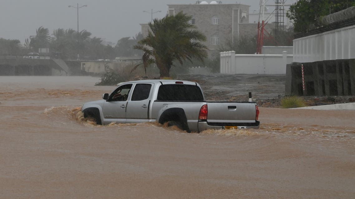 A SUV makes it way through a flooded street as Cyclone Shaheen makes landfall in Muscat Oman, October 3, 2021. (Reuters)