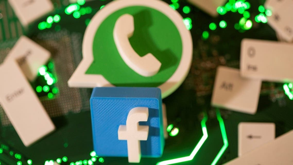 The 3D printed Facebook and WhatsApp logos and keyboard buttons are placed on a computer motherboard in this illustration taken Jan. 21, 2021. (Reuters)