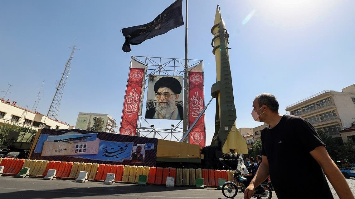 A Shahab-3 surface-to-surface missile is displayed next to a portrait of Iranian Supreme Leader Ayatollah Ali Khamenei, Sept. 25, 2021. (AFP)