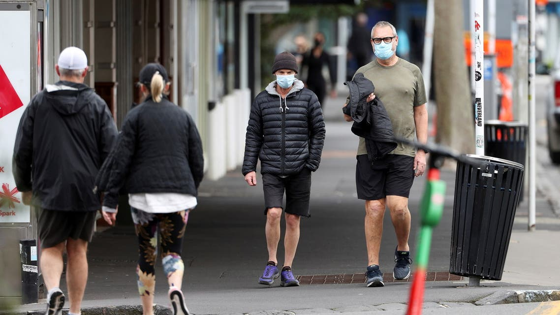 People wear masks as they exercise during a lockdown to curb the spread of a coronavirus disease (COVID-19) outbreak, in Auckland, New Zealand, August 26, 2021. (Reuters)