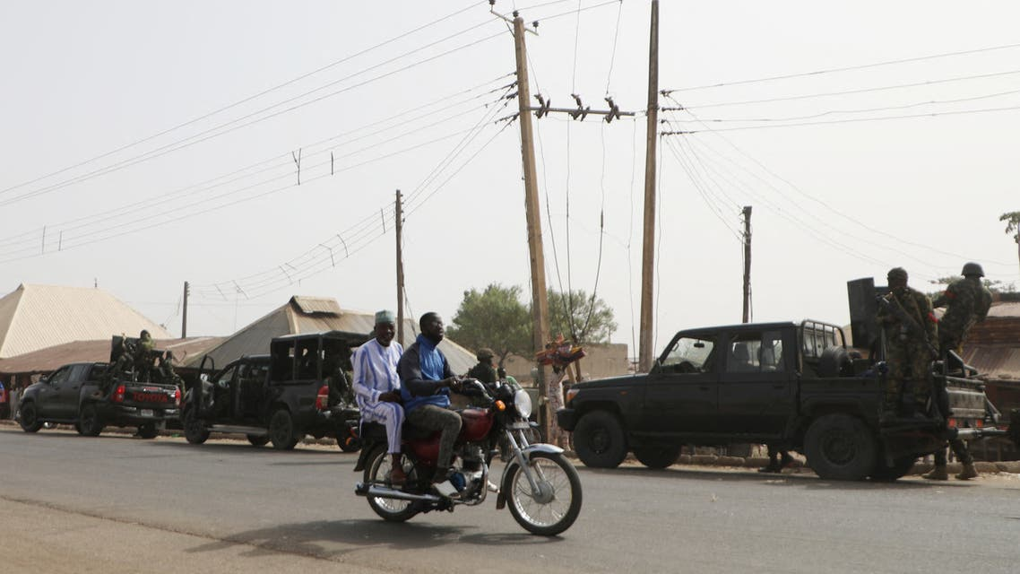 Nigerian military trucks are seen on the road in Kagara where gunmen kidnapped dozens of students and staffs of Government Science College, in Kagara, Rafi Local Government Niger State, Nigeria on February 18, 2021