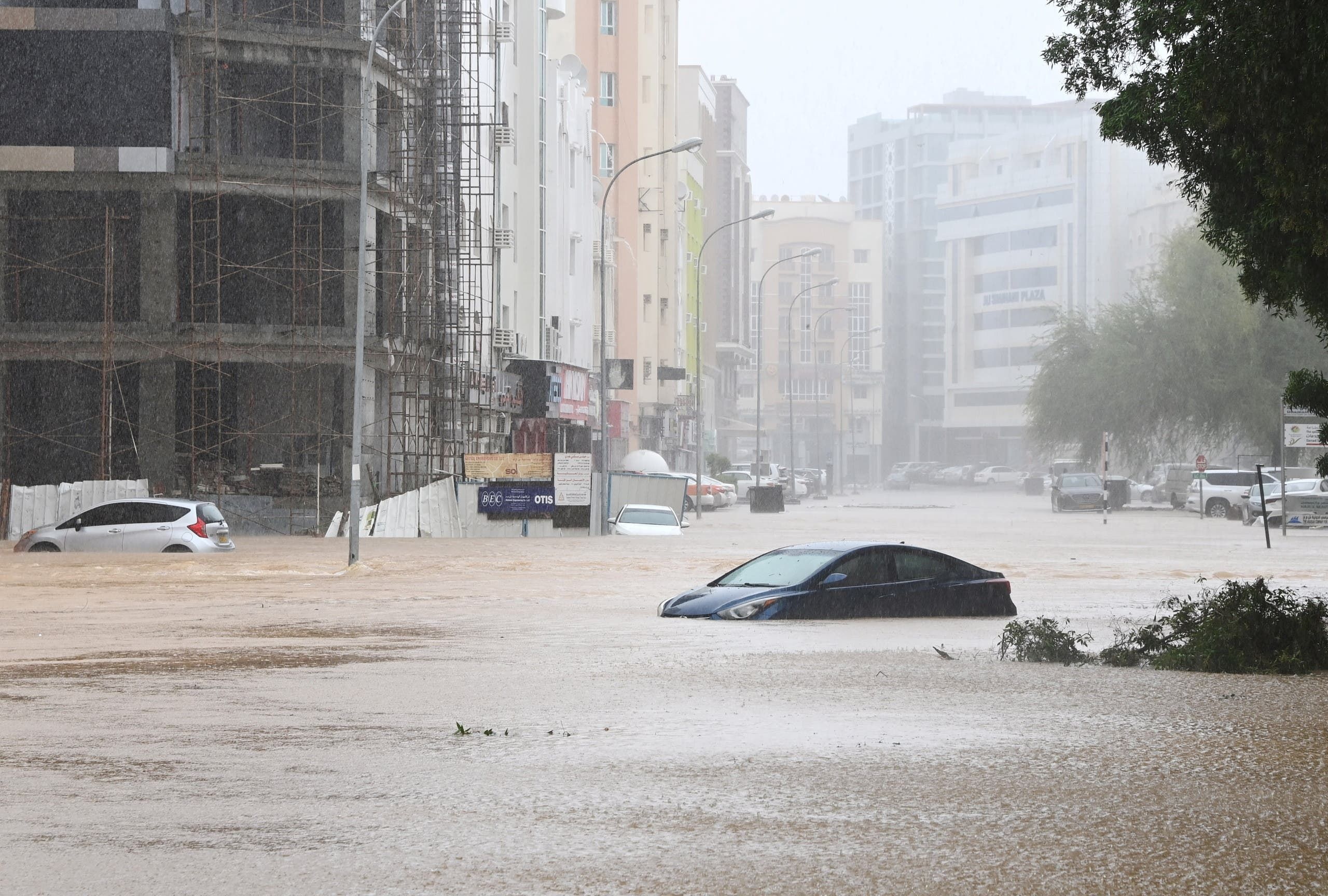 Cars are seen abandoned on a flooded street as Cyclone Shaheen makes landfall in Muscat Oman, October 3, 2021. (AFP)