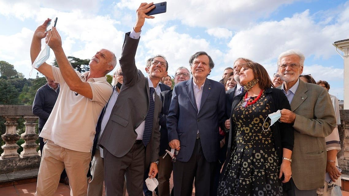 Italian theoretical physicist Giorgio Parisi , center, poses for a selfie photo with his colleagues at the Accademia dei Lincei , on  Oct. 5, 2021, in Rome, after being awarded the 2021 Nobel Prize for Physics, together with Syukuro Manabe and Klaus Hasselmann. (AP)