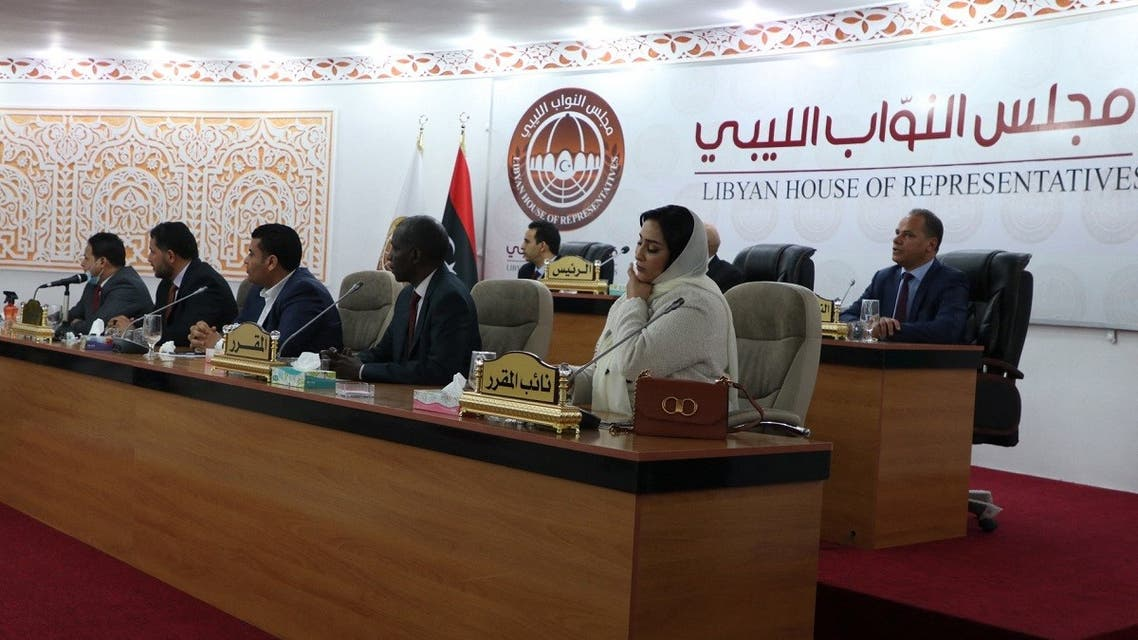 Members of Libya's parliament attend the swearing in ceremony for the country's new interim prime minister in the eastern Libyan city of Tobruk on March 15, 2021. (AFP)