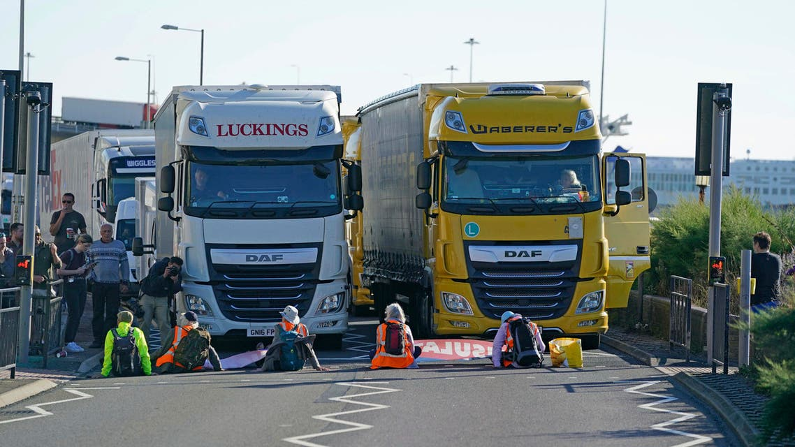 Protesters from Insulate Britain block the A20 road which provides access to the Port of Dover, in Kent, England, Friday, Sept. 24, 2021. (AP)