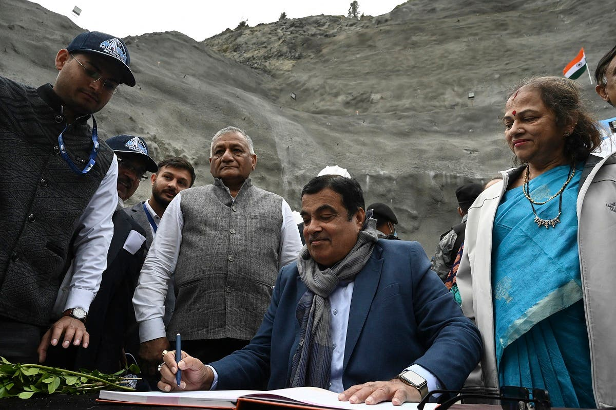 India's Union Minister of Road Transport and Highways (MoRTH) Nitin Gadkari (C), signs a register as inspects the Zojila tunnel under construction which connects Srinagar to the union territory of Ladakh, at Baltal, some 93 km northeast of Srinagar, on September 28, 2021. (AFP)
