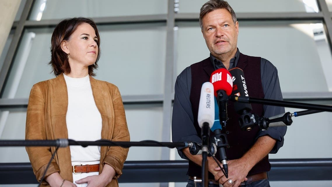 The Greens party co-leaders Annalena Baerbock and Robert Habeck give a statement after a party leadership meeting in Berlin, Germany, on October 6, 2021. (Reuters)