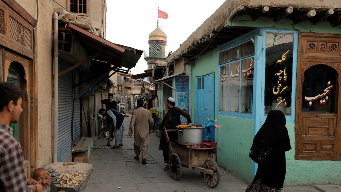 People walk in a square of an old neighborhood in Kabul, Afghanistan, on October 5, 2021. (Reuters)