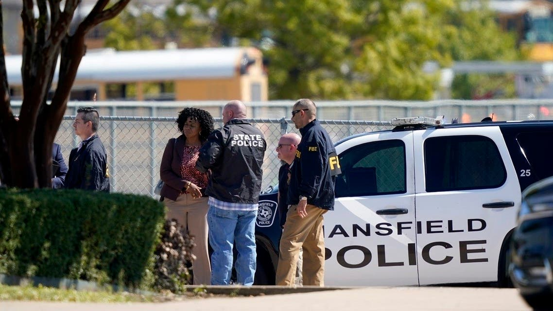 Law enforcement officers from different agencies gather in the parking lot of Timberview High School after a shooting inside the school located in south Arlington, Texas, Wednesday, Oct. 6, 2021. (AP/LM Otero)